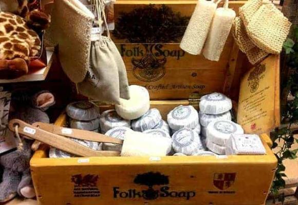 folk soap shop display image with loofah and exfoliating gloves